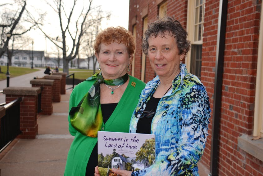 """Carolyn Epperly and Elizabeth """"Betsy"""" Epperly display the book they wrote and illustrated together, prior to the book launch at UPEI on May 2."""
