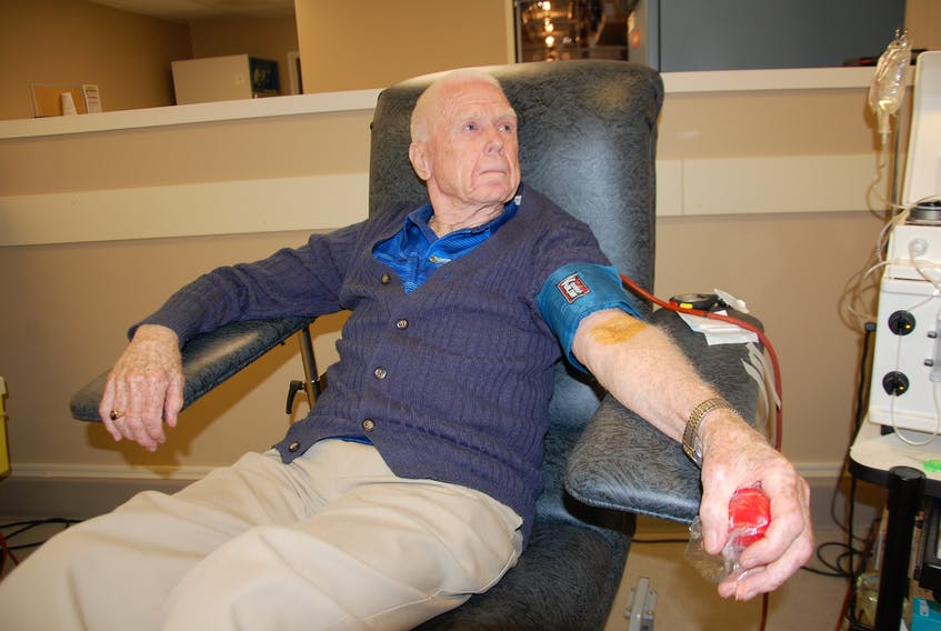 Ewen Stewart, 86, of Stanhope prepares to give his 1,000th blood donation Tuesday at the Charlottetown blood donor centre. Stewart is the first person on P.E.I. to reach this milestone. He donates plasma every week, a blood component that is used to help treat bleeding disorders, liver diseases and many types of cancer.
