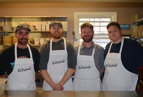 The co-owners of Nimrods', from left, Don Weir, Nigel Haan, Jesse Clausheide and Mikey Wasnidge, have donned their aprons and are rolling up their sleeves to help out at the Upper Room Hospitality Ministry Soup Kitchen in Charlottetown. For every pizza they sell at their floating pizza bar on the waterfront they will provide a hot meal for those in need at the soup kitchen.