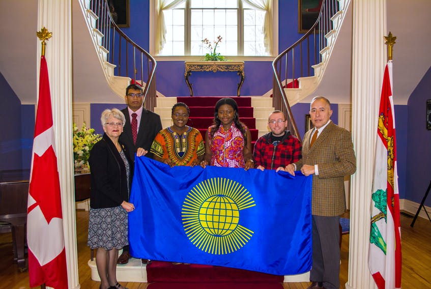 P.E.I. Lt.-Gov Antoinette Perry, left, joins UPEI Commonwealth students Tamish Boodhun of Mauritius, Aanu Owoeye of Nigeria, Chinwe Okwuwolo of Nigeria, Ricky Jamer and Horatio Toledo, president of the Royal Commonwealth Society of P.E.I., in getting ready to raise the Commonwealth flag. On Monday, March 12, 7 p.m., the society is holding a special Commonwealth service at the Kirk of St. James Presbyterian Church in Charlottetown. March 12 is also the 50th anniversary of independence for the country of Mauritius. In that regard, Boodhun said he is proud to be a citizen of Mauritius and a member of the British Commonwealth.