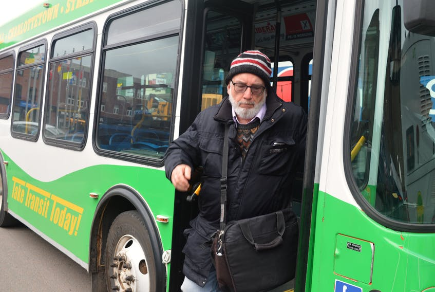 A passenger gets off the bus on Grafton Street in Charlottetown Thursday. The city is launching a six-month pilot project this month that will see the transit service expand in terms of routes and timing.