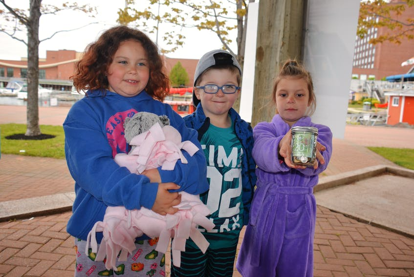 Six-year-old Charlottetown residents Peyton Corcoran, left, Keegan Mamye and Becca Barkhouse donated money during the second annual PJ Walk for Kids in Charlottetown on Sunday. About 500 P.E.I. participants raised more than $60,000 in the walk in support of Ronald McDonald House Charities, which provides a place for families to stay when going to Halifax for medical treatment.