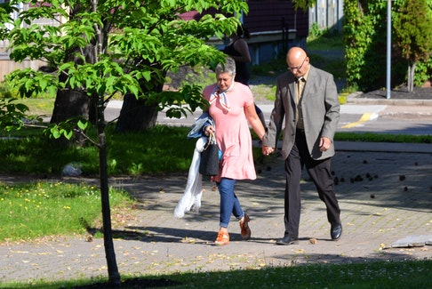 Kim and Roger Jabbour head into the provincial courthouse in Charlottetown on July 10. Roger Jabbour is charged with eight sex-related offences. He has pleaded not guilty to all charges.