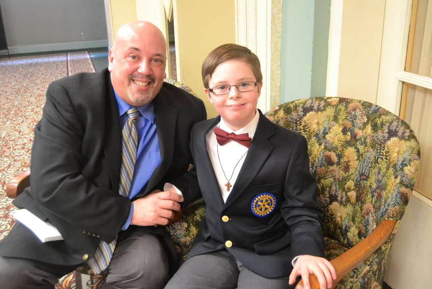 2018 Easter Seals Ambassador Brayden White is congratulated by his father, Melvin Ford, during the campaign kickoff at the Charlottetown Hotel on Monday.