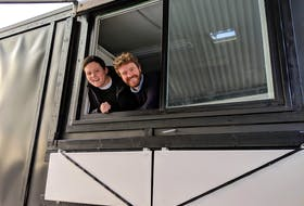 Mikey Wasnidge and Jesse Clausheide poke their heads out of the window of their food truck. They bought the trailer on a whim and plan to open their business, Nimrods', on March 29.