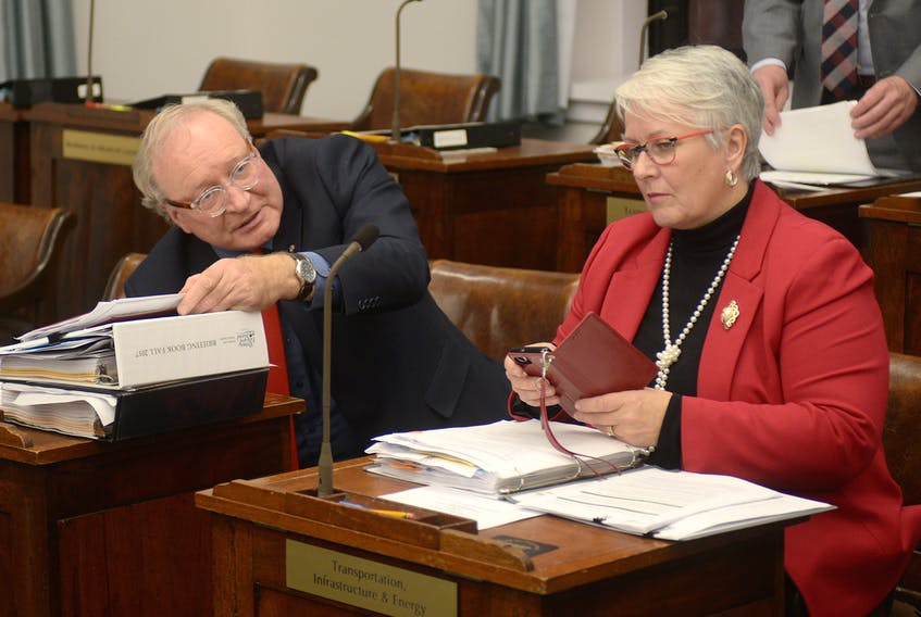 P.E.I. Premier Wade MacLauchlan and Liberal MLA Paula Biggar are shown in the legislature Wednesday.
