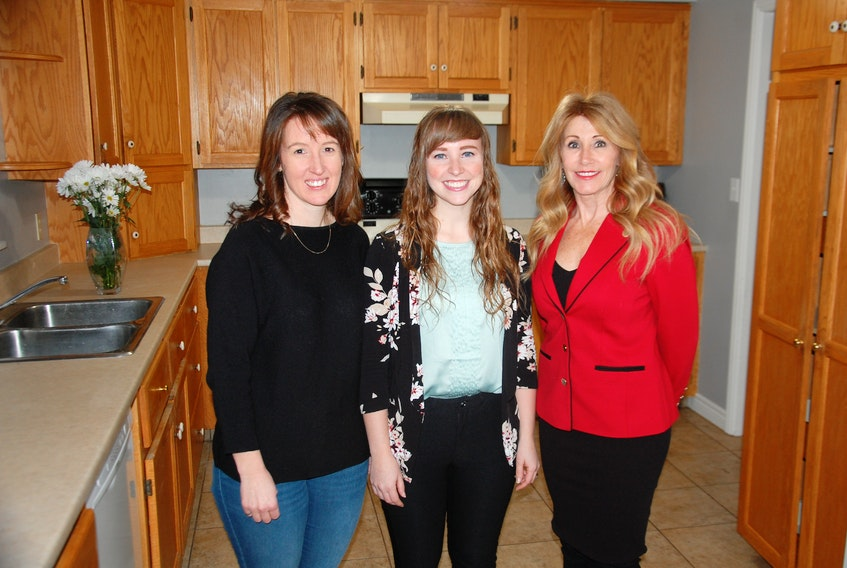 Family and Human Services Minister Tina Mundy, right, has praises Blooming House co-founders Brynn Devine, left, and Liz Corney for filling a void by opening a women's shelter in Charlottetown. The province announced Monday $60,000 in funding support for the initiative.