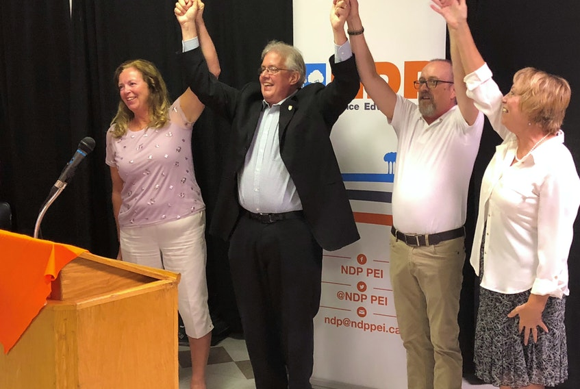 Leah-Jane Hayward, left, P.E.I. NDP Leader Joe Byrne, Gordon Gay and Lynne Thiele celebrate at a recent gathering in Charlottetown where the other three joined Byrne as nominated candidates for the NDP in the next Prince Edward Island provincial election.