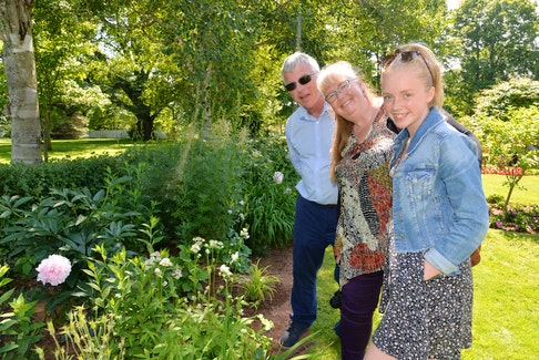 Sophie Flower, 15, right, Sue Flower and Chaz Flower, enjoyed a stroll through the garden at Government House on Tuesday at the annual garden party.