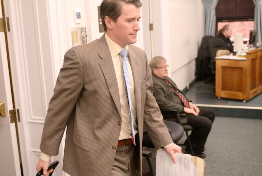 Justice Minister Jordan Brown enters the P.E.I. legislature before question period on Thursday.