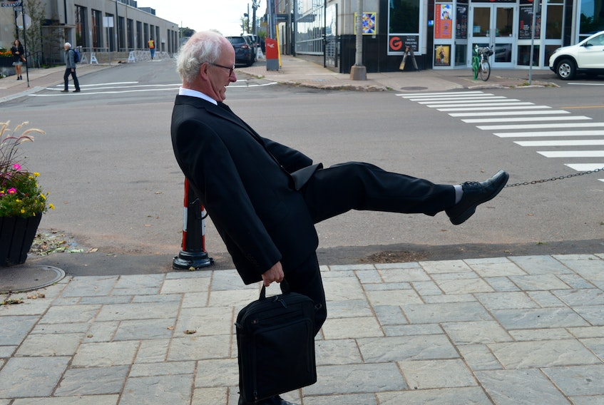 Mark Sandiford, executive director of CreativeP.E.I., does his best impression of John Cleese of Monty Python fame on Charlottetown's new silly walk crosswalk, located parallel to Queen Street across Richmond Street at Victoria Row. The idea came from a woman on the city's arts advisory board.