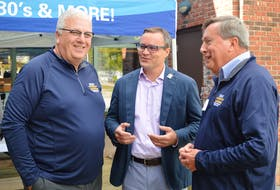 Evan Johnston, centre, chairman of the Canada Games Bid Evaluation Committee, speaks with co-chairs of the P.E.I. on Thursday Brian McFelly, left, and Wayne Carew. A rally was held at Founders' Hall in Charlottetown for the 2023 Canada Winter Games, which P.E.I. is hoping to get.
