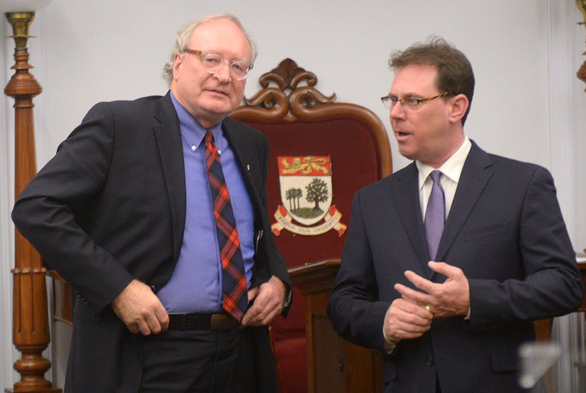 P.E.I. Premier Wade MacLauchlan, left, and PC leader James Aylward speak in the legislature after the fall session wrapped up Wednesday, Dec. 20, 2017.