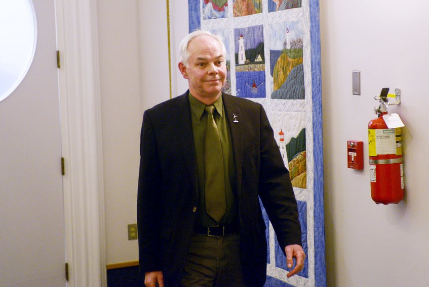 Green leader Peter Bevan-Baker leaves the P.E.I. legislature after being escorted out by the sergeant at arms Wednesday, Dec. 20, 2017.