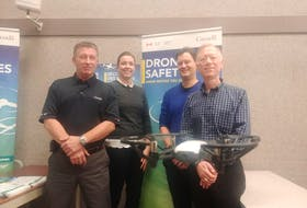 A micro drone hovers in front of Transport Canada employees Roger Smith, Jeannie Stewart-Smith, Tom Hastie and Carl Warren, who recently spoke to Islanders about new regulations coming into effect regarding the unmanned aerial vehicles.