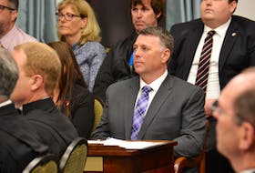 Premier Dennis King listens to the reading of the speech from the throne on Friday, June 14. The speech passed through the legislature in a unanimous vote on Thursday night.