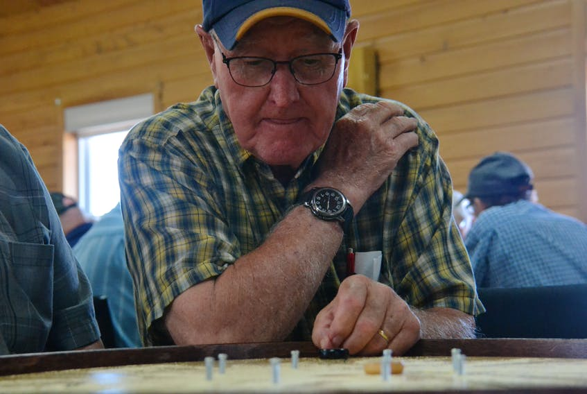 Lawson Lea and Wilfred Smith competed at the Roy Younker Memorial Tournament in St. Peter's Bay on July 20. The doubles partners placed third at the 2018 World Crokinole Championship. Daniel Brown/The Guardian.