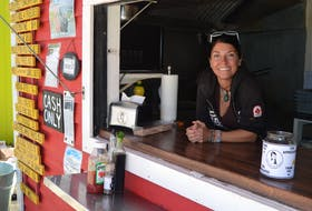 """Caron Prins, also known as the """"Queen of Fries'', owns the Chip Shack which was the first food hut to open at the Peakes Quay Marina. Prins will soon be joined by a variety of other food huts as the marina creates the Island's first floating food court."""