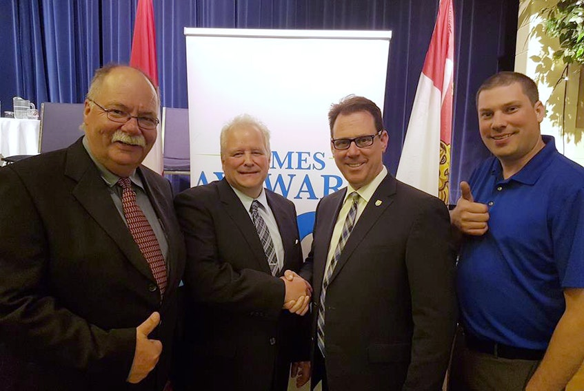 District 23 President Barry Balsom, left, newly nominated District 23 PC candidate Hilton Maclennan, PC Party Leader James Aylward and PC Party President Charles Blue.
