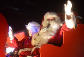 Santa waves out to the crowd during the 2018 Christmas Parade in Charlottetown.