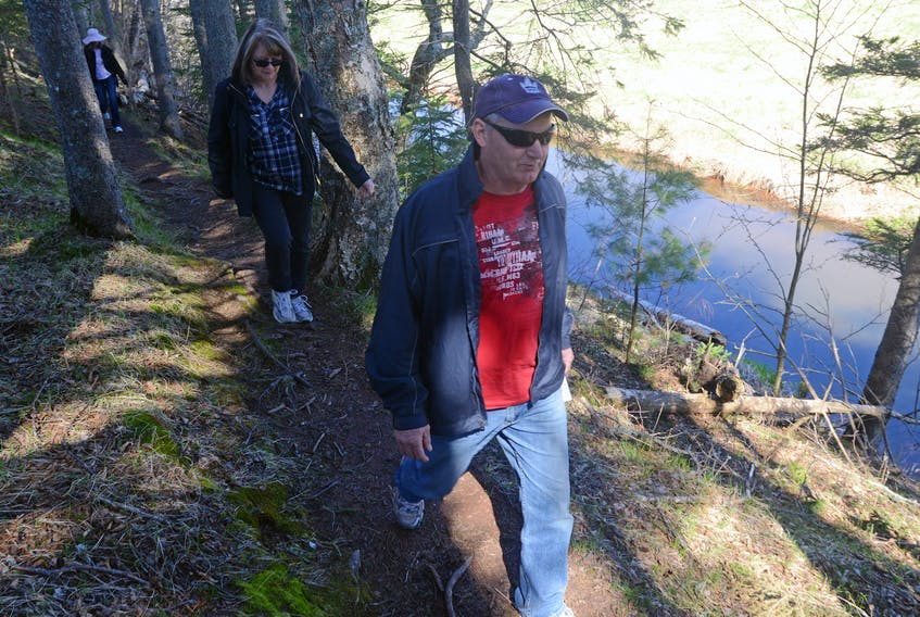 Kent and Brenda Biggar, followed by Eileen O'Grady, make their way through the Breadalbane Nature Trail next to the Dunk River as part of the Go! Hike event organized by Go! P.E.I. and Island Trails. The summer hiking series encourages Islanders to enjoy the province's destination trails during the 25th anniversary of Island Trails.