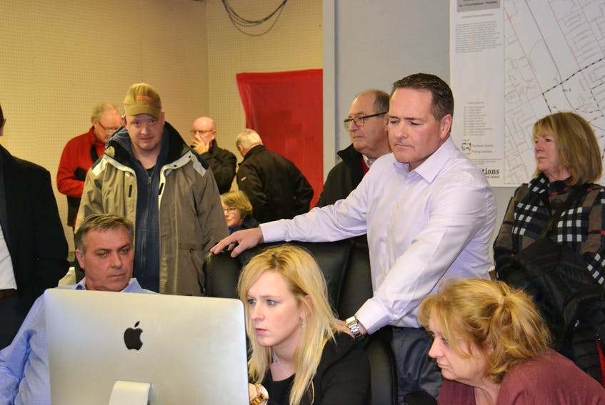 Liberal candidate Bob Doiron, right, is surrounded by supporters at his campaign headquarters Monday evening as they watch results come in from the District 11 byelection. Doiron finished second to Green party candidate Hannah Bell. (Teresa Wright/The Guardian)