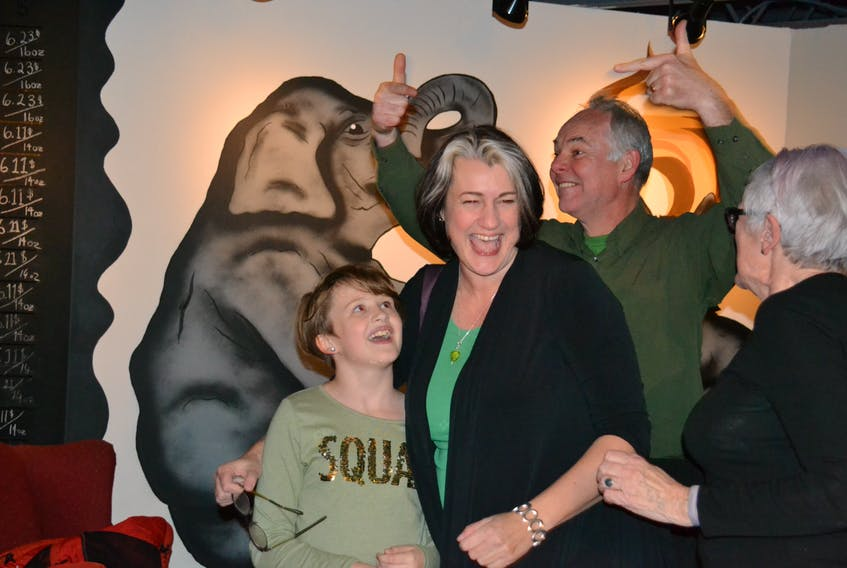 Green party candidate Hannah Bell, second from left, is congratulated by her daughter, Ava, party leader Peter Bevan-Baker and her mother Judith after winning the District 11, Charlottetown-Parkdale byelection on Monday. (Teresa Wright/The Guardian)