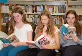 Grade 8 students of Queen Charlotte Intermediate in Charlottetown, from left to right, Kate Ford, Claire De Jong, and Olivia Devine participate in a literature circle in the school library. Results of the Pan-Canadian Assessment Program, which measures the performance of Grade 8 students, shows P.E.I. is one of five provinces at or above the Canadian average in reading.