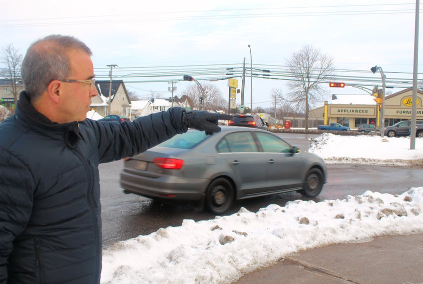 Charlottetown Mayor Philip Brown points to the intersections by Vogue Optical that connect St. Peter's Road, Brackley Point Road and Belvedere Avenue. Brown said he would like to see some action this year on a proposed roundabout for the area.