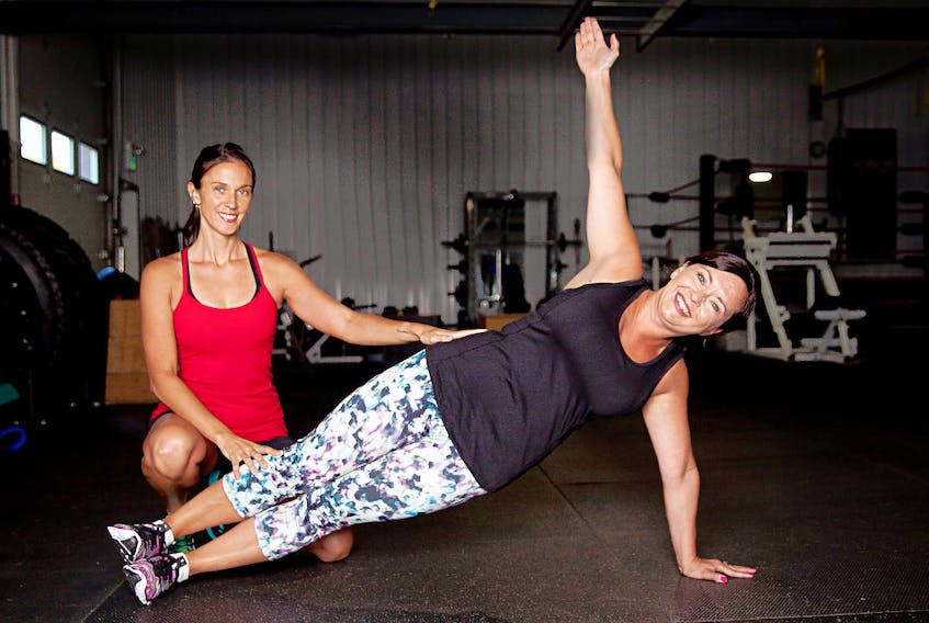 Fitness instructor Doris Ward, left, gives a personal training session to her client, Stacey Wyand. Mike Bernard Photography