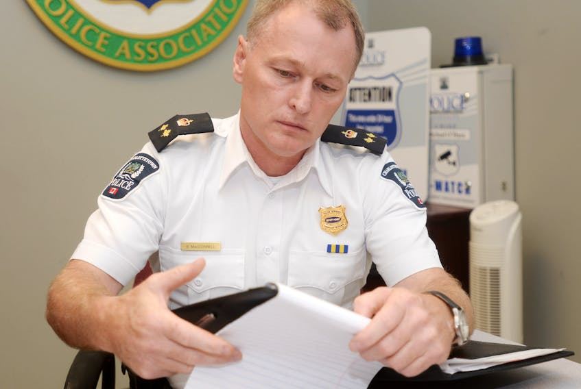 Deputy Police Chief Brad MacConnell makes some notes at the Charlottetown police station on Monday shortly after the department announced it had charged a 39-year-old city woman with two counts of infanticide. The charges, which followed more than a year of investigation, are related to incidents from 2014 and 2016.