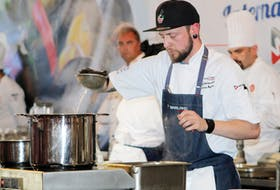 Chef Darren Rogers of Montreal, Que. Prepares some mussels during the Garland Canada International Chef Challenge during this year's P.E.I. International Shellfish Festival. Rogers won the $10,000 competition by preparing a pangrattato crusted lobster tail in a lobster romesco sauce, an oyster Caesar with lemon-dressed greens, caramelized leeks, fennel-steamed mushrooms and some pickled mussels.
