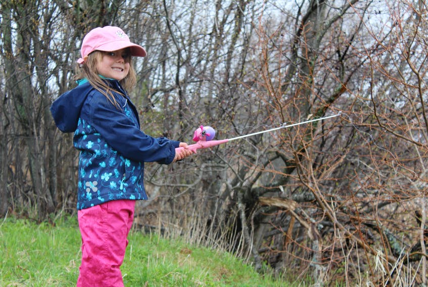 Quinn Kirby, 5, of Cornwall spent time with her family while fishing at Hyde Pond on Saturday. The pond, which was closed following a 2017 fish kill, was re-opened for the long weekend and stocked with trout in hopes that it can stay permanently open for the 2020 fishing season.
