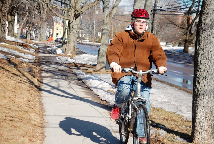 Levi Arsenault, 21, of Charlottetown couldn't wait for the first day of spring Wednesday to return to cycling. He says he has had his bike out a few times over the past week or so – his main mode of transportation in all seasons but winter. Although the calendar says spring has arrived, Islanders can expect rain, wind and maybe even snow at the end of this week as Environment Canada has issued a special weather statement for the entire province, warning of a low-pressure system that is expected to track northeastward towards the Maritimes on Friday, bringing rain, strong winds and potentially some snow beginning Friday and ending during the day Saturday. JIM DAY/THE GUARDIAN