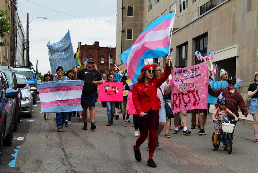 Participants march in support of transgender rights during Charlottetown's first Stonewall March held on Saturday. Those in attendance marched through the city waving flags and signs to support transgender people as well as commemorate the 50th anniversary of the Stonewall riots. KATHERINE HUNT/THE GUARDIAN