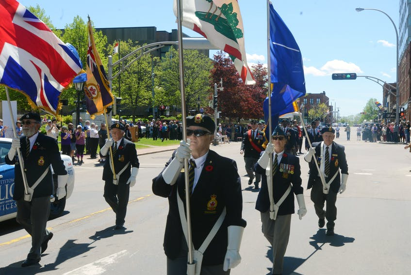 Members of the Royal Canadian Legion Colour Party lead a parade in Charlottetown on Sunday commemorating the 75th anniversary of D-Day.