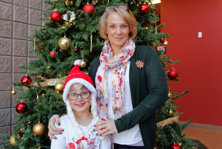 Nancy Fullarton and her eight-year-old daughter, Sophie, celebrate during the P.E.I. Military Family Resource Centre's Christmas party at the Murchison Centre Sunday. The party was a chance for military members, veterans, RCMP and their families to share in some festive joy.