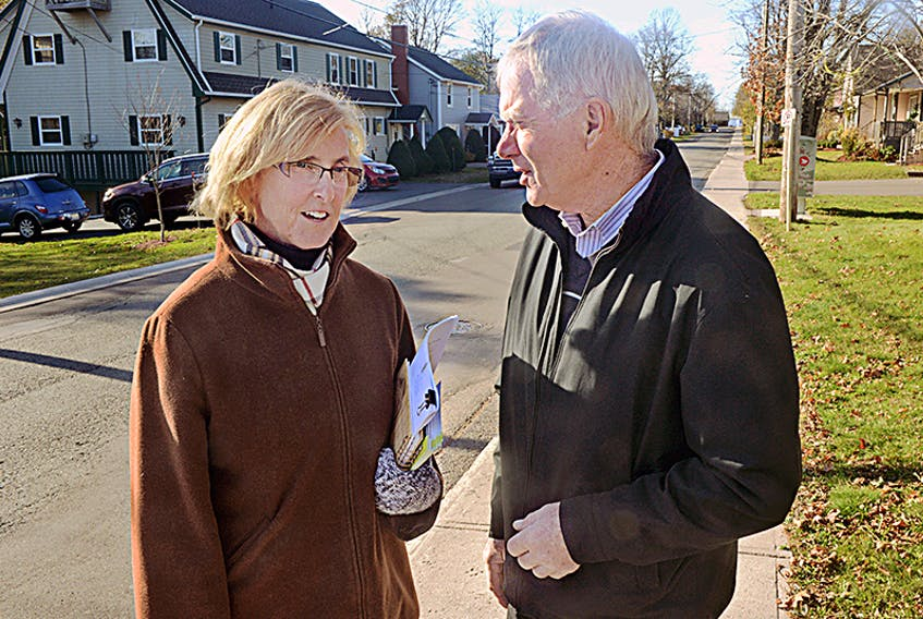 Progressive Conservative party candidate Melissa Hilton chats with supporter Chester Gillan, who is also a former PC cabinet minister, while campaigning earlier this month. Hilton says her 12 years of experience in Charlottetown city council will be an asset in the provincial legislature.  ©THE GUARDIAN