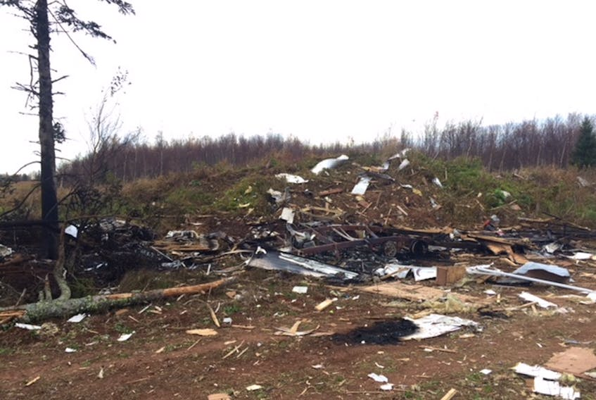 A passer-by took this photo of what used to be a 30-foot travel trailer that exploded in the back part of a farmer's field near Hampshire on Saturday. The RCMP is investigating the matter. (Submitted photo)