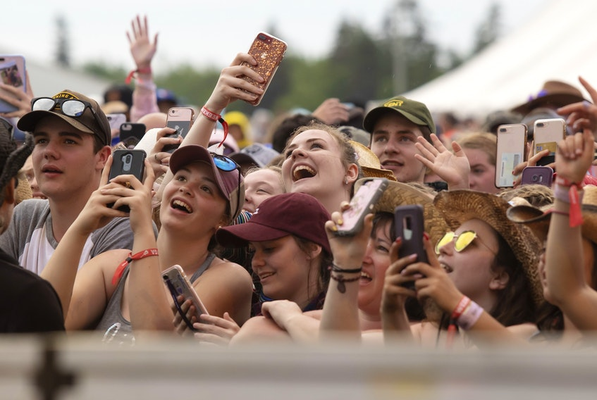 Festival-goers take out their phones to capture some of the performances at the Cavendish Beach Music Festival. Mike Bernard/ Cavendish Beach Music Festival photo.