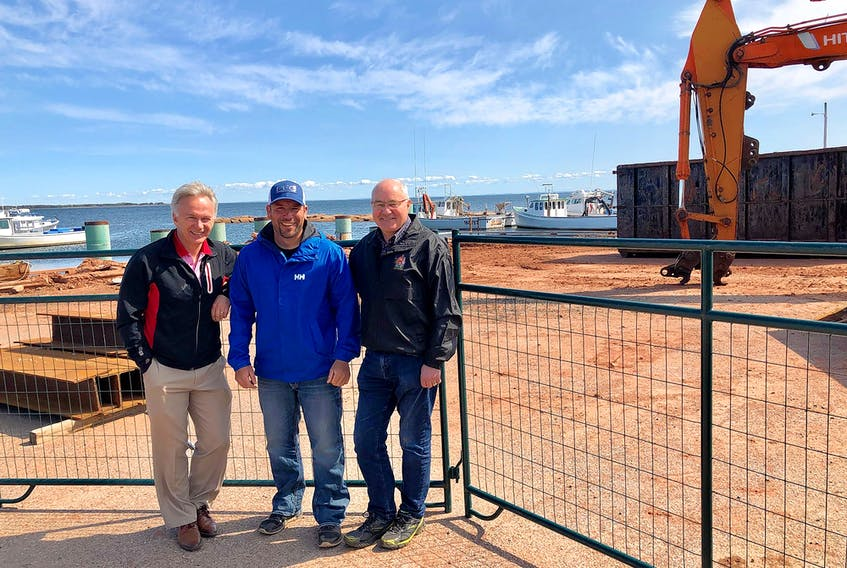 Charlottetown MP Sean Casey, left, along with Andrew Bryanton, president of the Nine Mile Creek Harbour Authority, and Malpeque MP Wayne Easter, right, pose for a photo after viewing the work being carried out at Nine Mile Creek Harbour. Construction currently underway to replace a portion of the wharf should be completed later this fall. As the harbour is currently at capacity, the work will expand the number of boats used for the commercial fisheries as well as for aquaculture. Nine Mile Creek Harbour has a dozen lobster boats and an equal number of boats for aquaculture operations such as mussels and oysters.