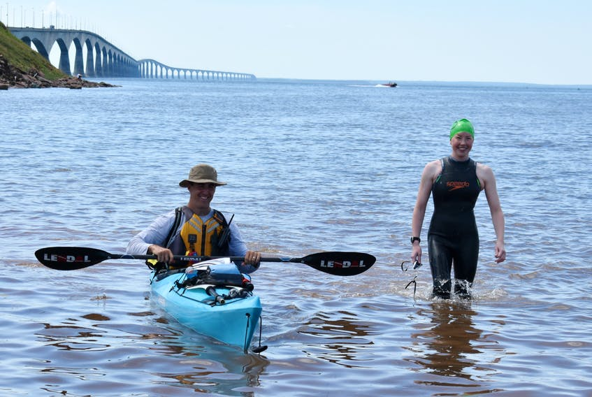Wendy and Shawn O'Connor travelled from New Brunswick to follow their daughter Colleen in the Big Swim. Colleen was accompanied in the water by their son Brendan in his kayak.