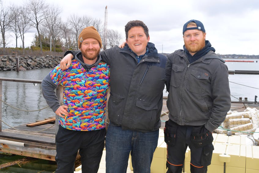 The co-owners of Nimrods', from left, Jesse Clausheide, Mikey Wasnidge and Nigel Haan, are planning to open a floating pizza bar at the Peake's Quay Marina in Charlottetown within the next two to three weeks. This operation will include a 5,000-pound wood fired oven.