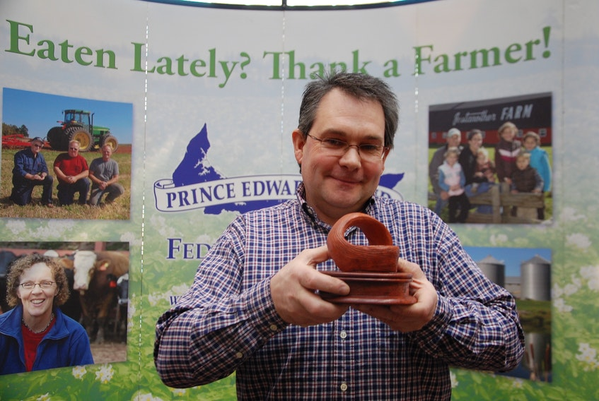 Darren Peters, of Somerset Farms in Maple Plains, holds up the 2019 Gilbert R. Clements Award for Excellence in Environmental Farm Planning. His farm was recognized with the award Friday at the P.E.I. Federation of Agriculture's annual meeting.