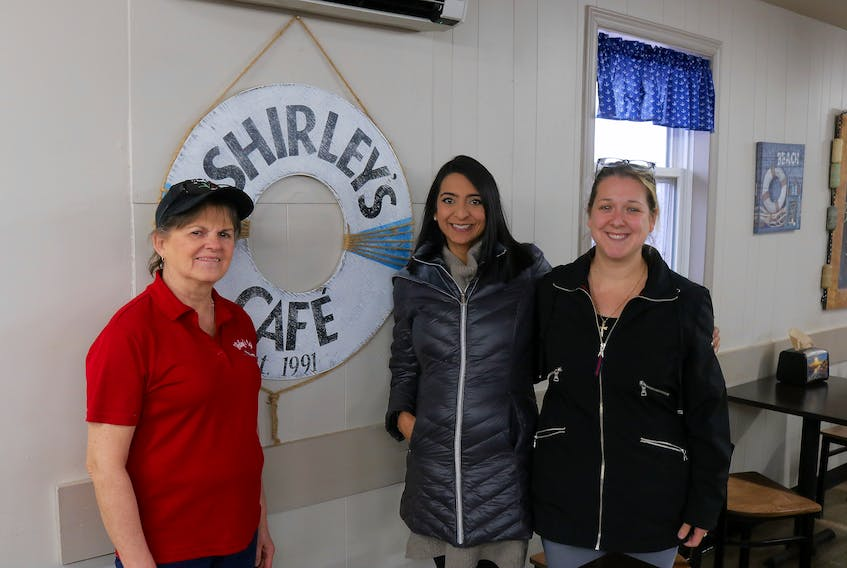 Shirley Harper, owner of Shirley's Place in Tignish, poses with PC candidate Melissa Handrahan and PC volunteer April Delaney after a lunch rush. Handrahan is running against Liberal incumbent Hal Perry. Stu Neatby/The Guardian