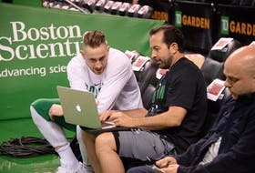 Morell's Scott Morrison, centre, an assistant coach with the Boston Celtics, talks with star forward Gordon Hayward.  (Submitted Photo)