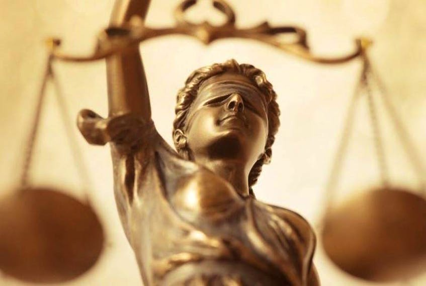 Lady Justice is an allegorical personification of the moral force in judicial systems. A blindfold represents impartiality, the ideal that justice should be applied without regard to wealth, power or other status. (File Photo)