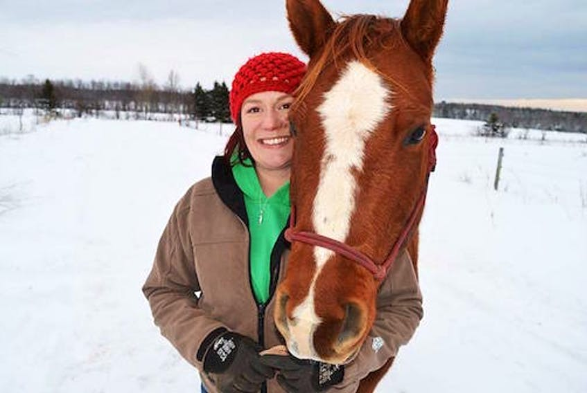 Ellen Jones, pictured here with Ginger, won her case for much higher compensation from the province which expropriated her therapeutic horse farm in Cornwall to make room for the bypass highway around the town.  (Guardian photo)