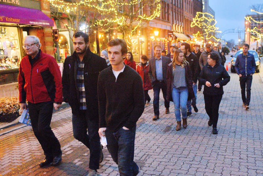 A group of about P.E.I. men, including, from left, Premier Wade MacLauchlan and Dana Kenny, centre, of the Prime Minister's Youth Council, marched down Richmond Street recently in solidarity with Island women following the second annual Stop the Violence event at The Guild. The event was hosted by P.E.I. Man Up, a volunteer advocacy group that aims to prevent all forms of violence against Island women and works with the P.E.I. Council of the Status of Women and The Women's Network of P.E.I. -Guardian photo