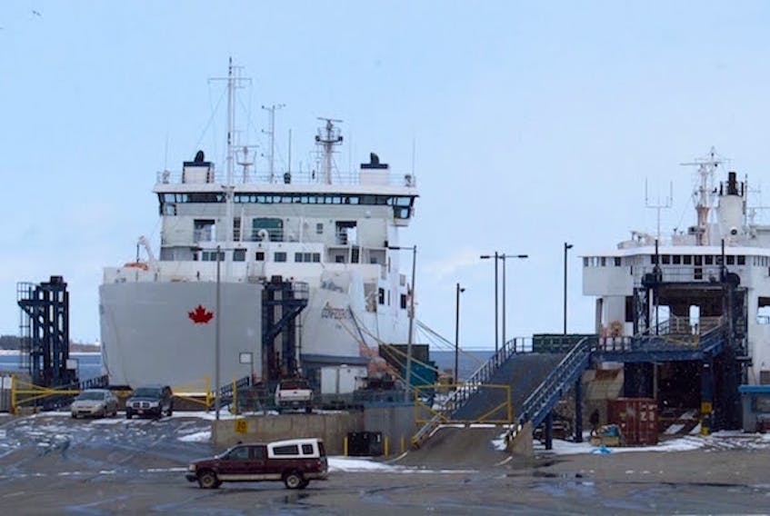 The MV Confederation, left, and Holiday Island are shown at the Wood Islands, P.E.I. ferry terminal. (Guardian File Photo)